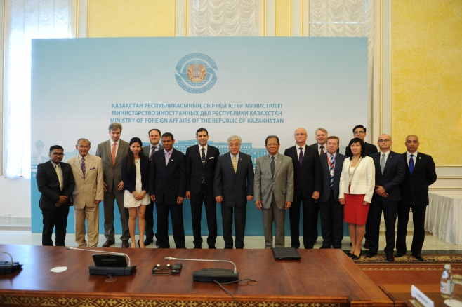 "Foreign Minister Erlan Idrissov (C) poses with winners and sponsors of the ""Kazakhstan Through the Eyes of Foreign Media"" contest on Aug. 24."
