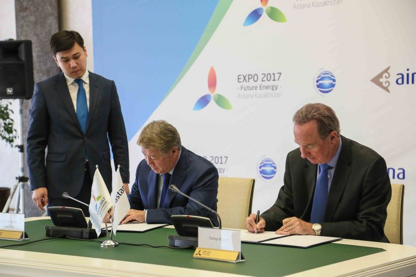 Chairman of Astana EXPO 2017 Akhmetzhan Yessimov (L) and  President of Air Astana Peter Foster sign the cooperation agreement making Air Astana the official airline of EXPO 2017 on Aug. 17.