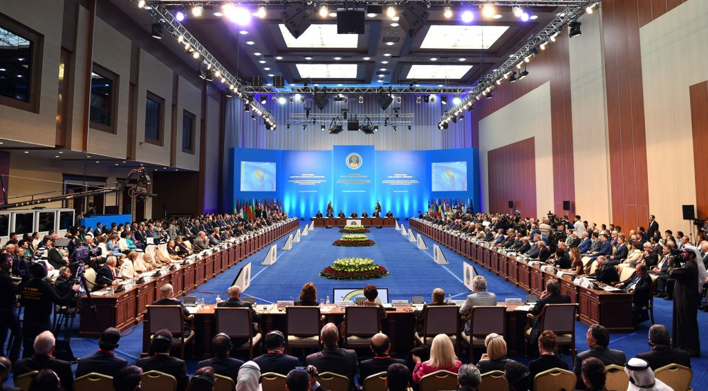 """Attendees gather at the """"Constitution: unity, stability and prosperity,"""" dedicated to the 20th anniversary of Kazakhstan's constitution."""