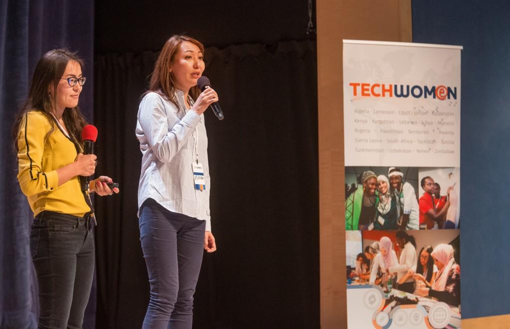 Gulshnar Salpykova, Elnura Kassymova presenting a project.