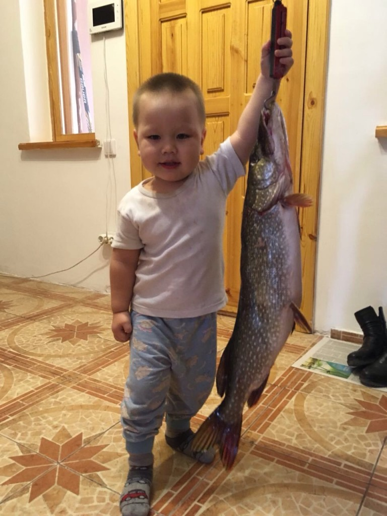 2-year-old-fishermans-grandson-kaisar-with-a-pike