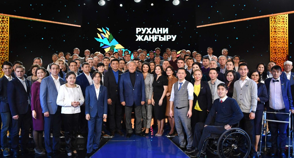 Nazarbayev with the project participants. Photo credit: akorda.kz