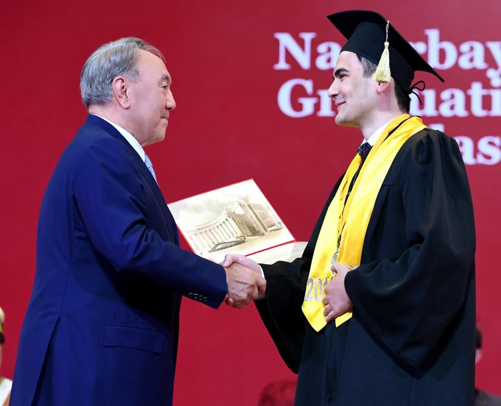 Kazakh President Nursultan Nazarbayev and graduate student Khamza Sharifzoda
