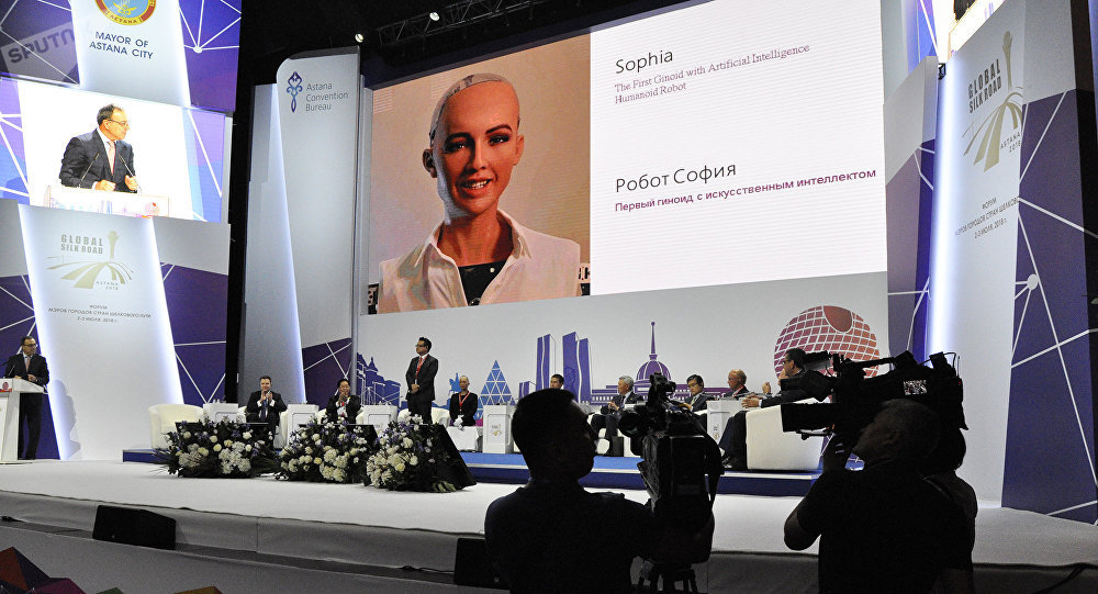 Robot Sophia at the Cities Mayor forum.  Photo credits:  sputniknews.kz.